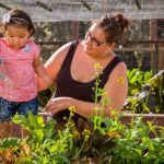 family feeding plants' soil, fertility