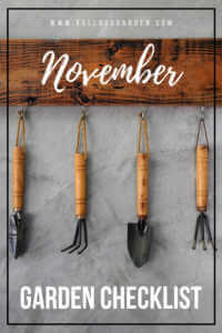 "Garden looks hanging from a wooden board with text, "" November garden checklist"""