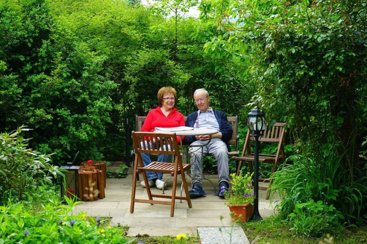 Active Senior Couple in beautiful garden