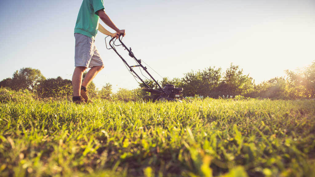 man mowing lawn in the spring