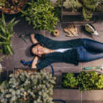 woman lying on rooftop garden