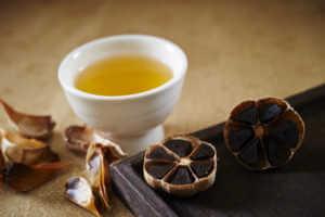 Black garlic with tea cup