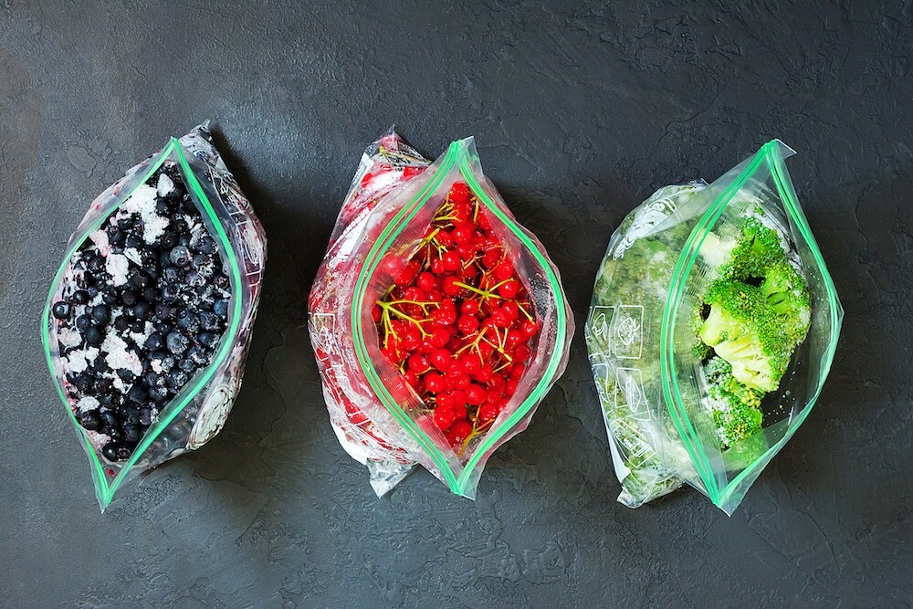 Frozen berries and vegetables in bags