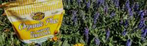 Kellogg Garden Organics Fertilizer in a bed of flowers
