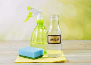 What and vinegar being mixed in a spray bottle.