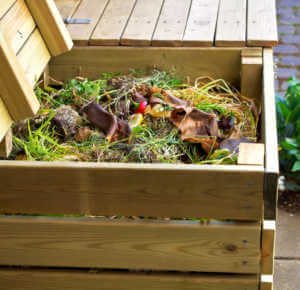 Compost in wooden box on sidewalk