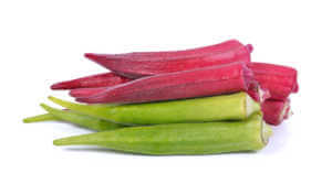 Fresh organic green and red okra isolated on a white background .