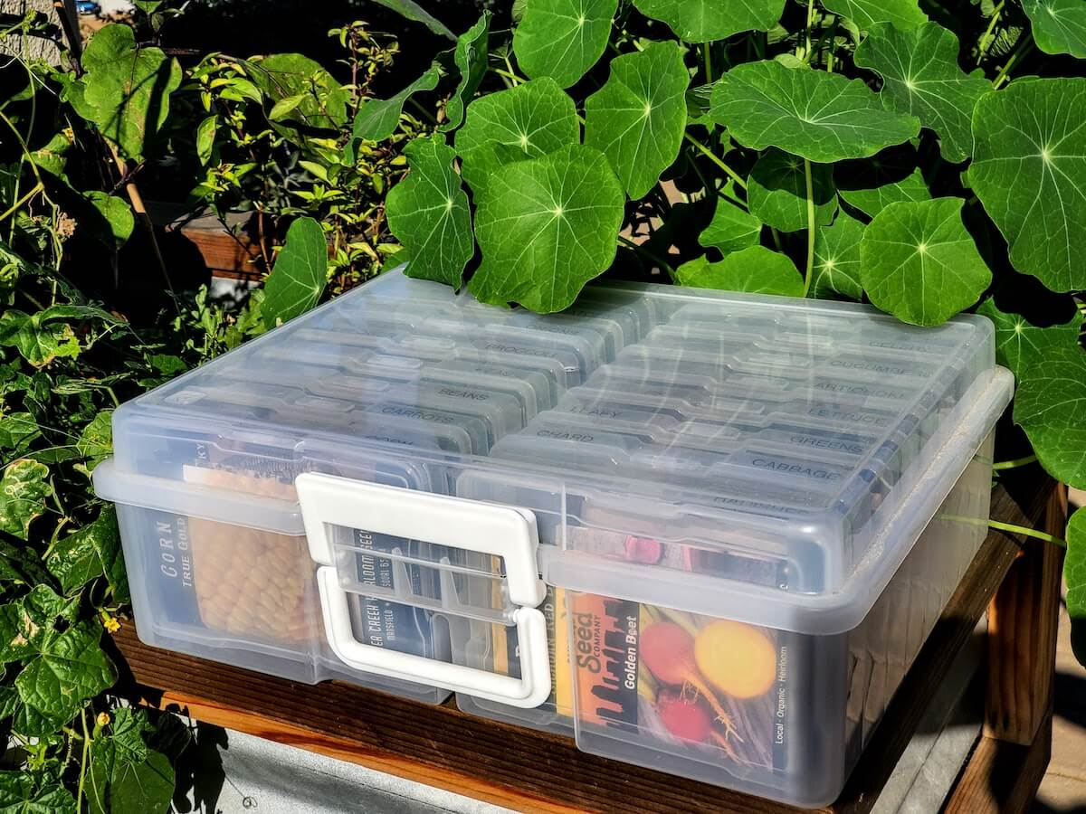 Box of seed packets in the garden.