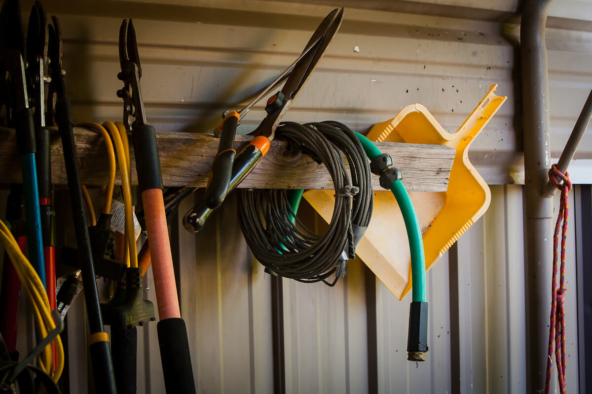 Garden tools hanging in a shed.