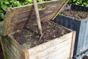 two open compost containers full of soil.
