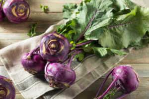 Raw Organic Purple Kohlrabi on wooden table.