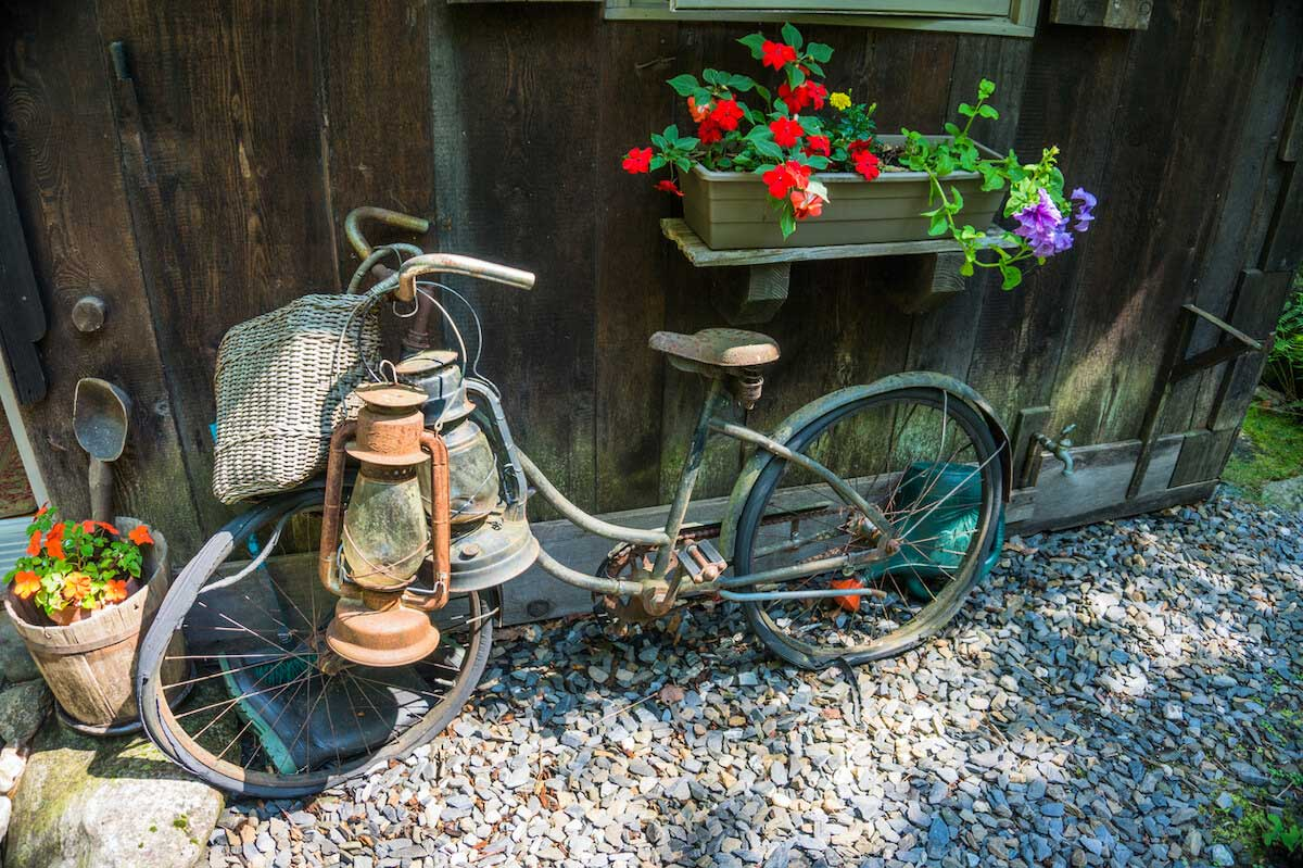.vintage old bike leaning against a house