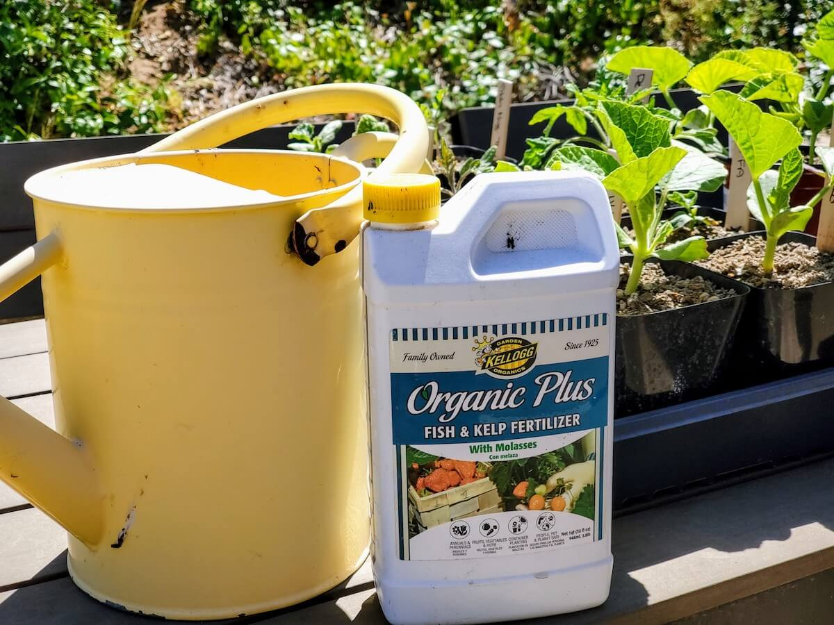 Fertilizer and yellow metal watering can
