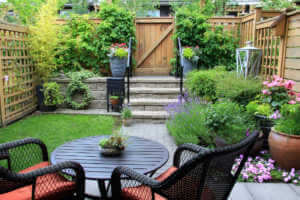 Small townhome garden with patio furniture.