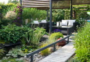 Modern patio garden lounge with a pond.