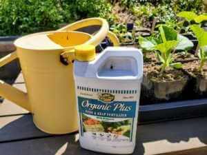Kellogg Organic Plus Liquid fertilizer and yellow watering can