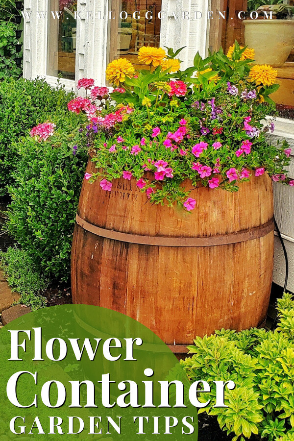 wooden barrel filled with colorful flowers