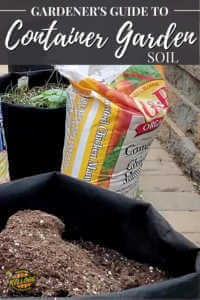 container full of soil with soil bag in the background