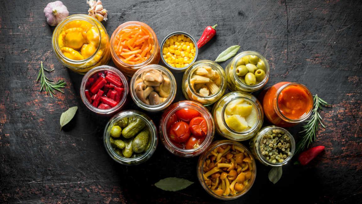Various preserved vegetables in jars.
