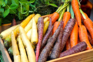colorful carrots harvest in wooden box