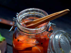 small wooden tons inside mason jar of pickled carrots