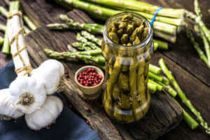 grilled and pickled asparagus fermented in glass jar