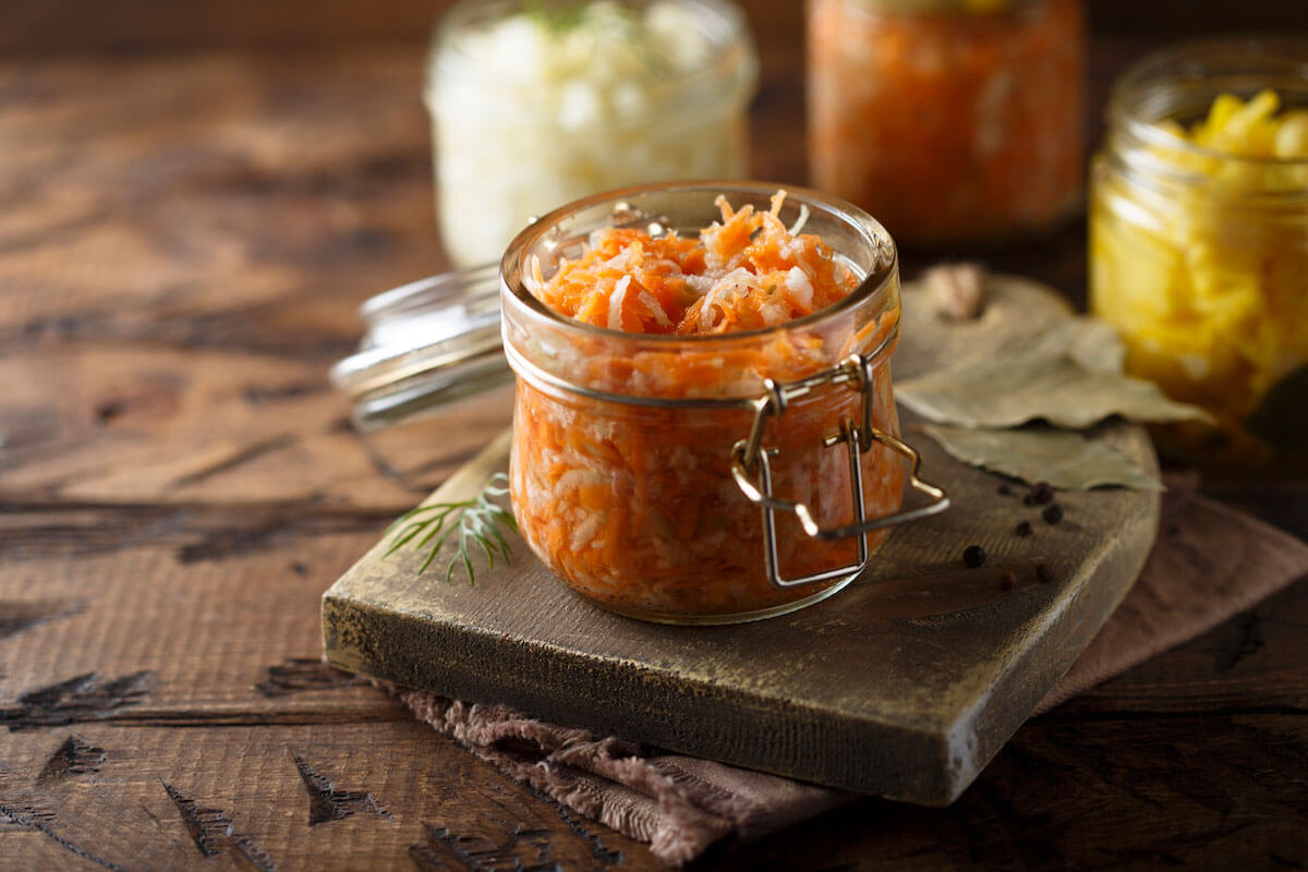 shredded carrots in a opened small glass jar.